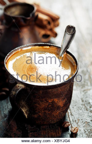Old coffee cup on dark rustic  background - Stock Photo