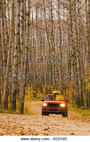 Truck on gravel road, Prince Albert National Park, Saskatchewan, Canada - Stock Photo