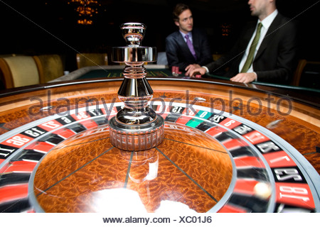 Two men gambling at roulette table - Stock Photo