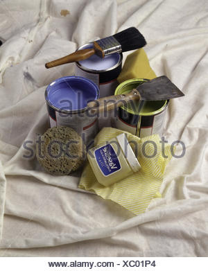 Tins of blue and green paint sith paint brushes - Stock Photo