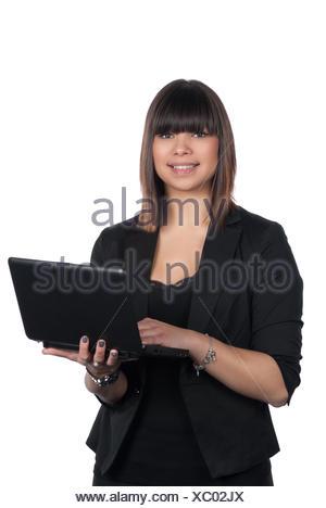 Freigestelltes Foto einer jungen Frau, die ein Netbook hält - Stock Photo