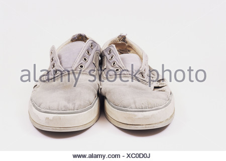Worn canvas shoes - Stock Photo