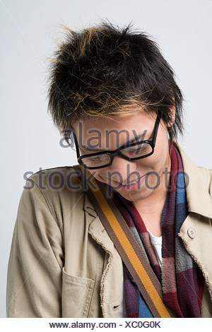 Shy young japanese man - Stock Photo