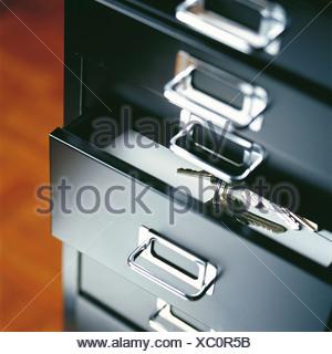 Bunch of keys in an open drawer - Stock Photo
