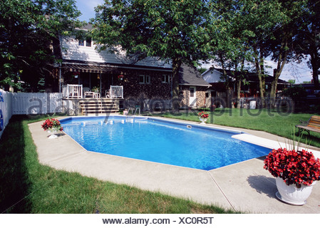Swimming pool in garden - Stock Photo