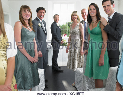 Wedding guests looking down aisle - Stock Photo