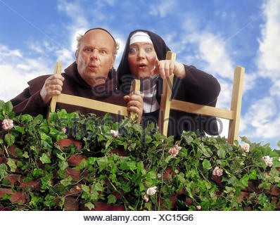 Hedge, monk, nun, conductor, stand, show gesture, astonishment, Composing, professions, studio, order woman, cloister sister, priests, friar, priest, curiously, curiosity, is surprised, astonished, observe, observation, in amazement, surprise, astonishment, dumbfounded - Stock Photo