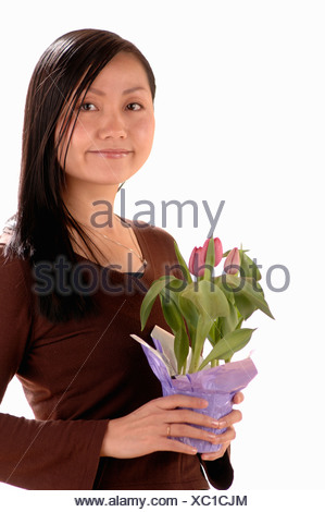 Asian Young girl w/Flower, Regina, Saskatchewan - Stock Photo