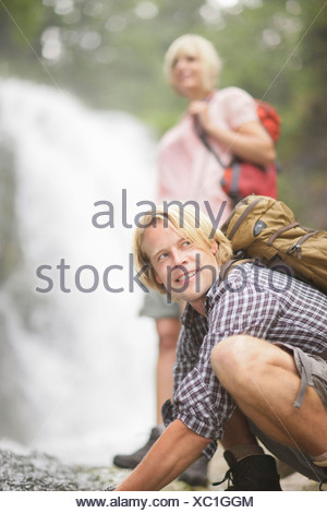 Hikers near waterfall, Werdenfelser Land, Bavaria, Germany - Stock Photo