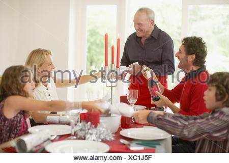 Family enjoying Christmas dinner - Stock Photo