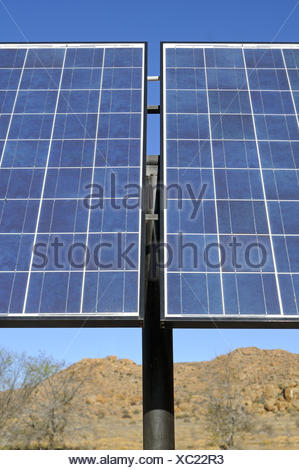 Solar panels in use in a semi-desert environment - Stock Photo