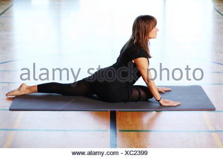 Woman doing Yoga exercises - Stock Photo