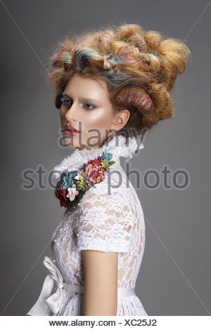 Updo. Dyed Hair. Woman with Modern Hairstyle. High Fashion - Stock Photo