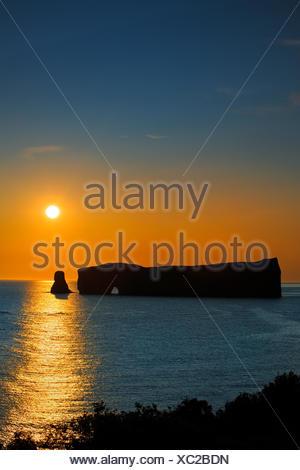 Rocher percé  (Percé Rock)  at sunrise and the Atlantic Ocean Percé  Quebec Canada - Stock Photo