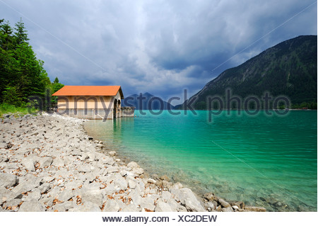 Boathouse on Walchensee lake, Mt. Jochberg on the horizon, district of Bad Toelz-Wolfratshausen, Bavaria, Germany, Europe - Stock Photo