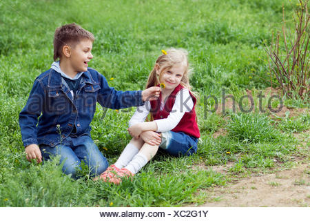 boy giving flowers to a girl - Stock Photo