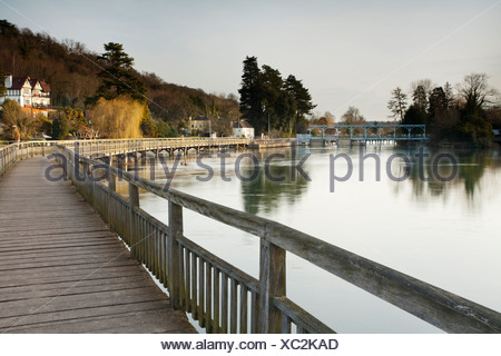 Looking along the wooden footbridge over the River Thames towards Marsh Lock near Henley on Thames in Oxfordshire, Uk - Stock Photo