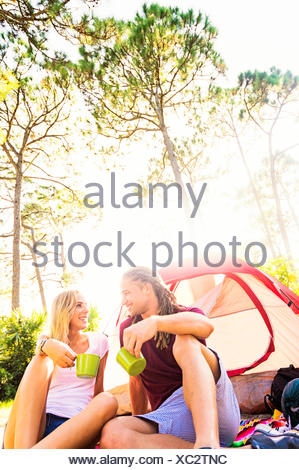 USA, Florida, Tequesta, Couple sitting with coffee in front of tent - Stock Photo