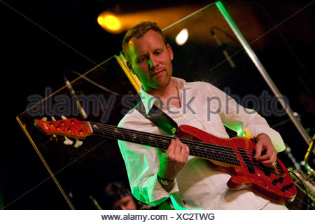 Mario Thuerig, bassist of the Swiss BrazzFunk formation Spinning Wheel performing live in the Schueuer, Lucerne, Switzerland, E - Stock Photo