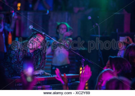 Musician playing synthesizer on stage at music festival, San Bernardino County, California, USA - Stock Photo