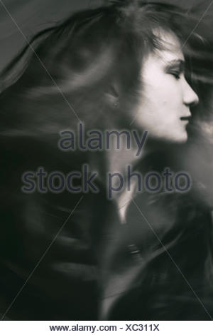 Young woman in studio, motion, profile, portrait, - Stock Photo