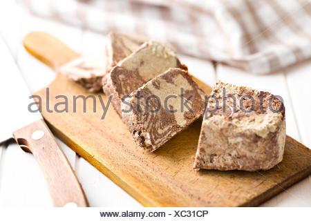 pieces of tasty halva on kitchen table - Stock Photo