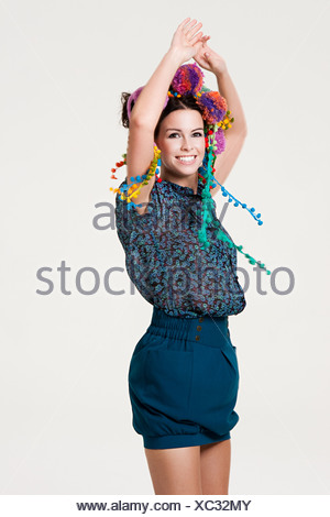 Young woman wearing a headdress - Stock Photo