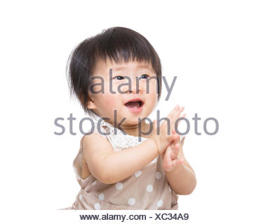 Asiab baby girl feeling excited - Stock Photo