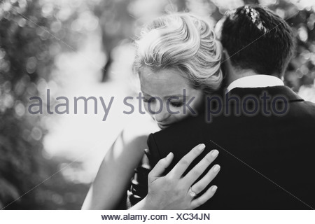 A Bride And Groom In An Embrace; Pemberton, British Columbia, United States Of America - Stock Photo