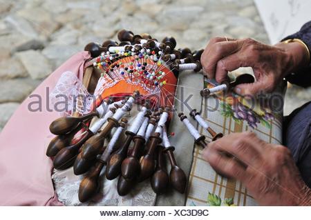 Old woman making lace, Le Puy-en-Velay, Haute Loire, Auvergne, France - Stock Photo
