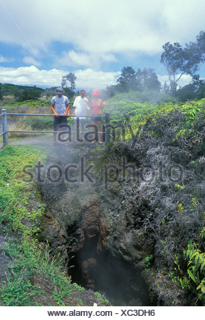 People get a close up view of the Steam Vents along Steaming Bluff. Located along Crater Rim Drive and Kilauea Volcano in - Stock Photo