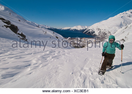 Alaska, Portage Pass in the Chugach National Forest from Whittier to Portage Lake in winter with snowshoes. - Stock Photo