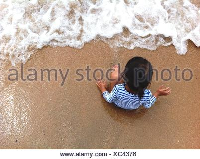 High Angle View Of Child On Beach - Stock Photo