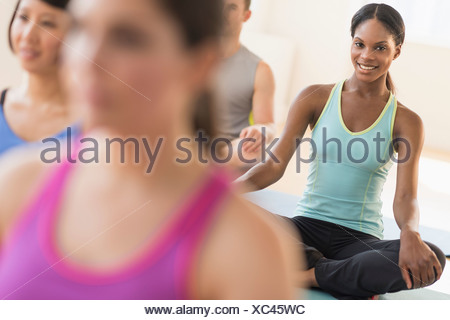 People training yoga in gym - Stock Photo