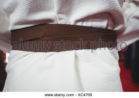 Karate player in black belt - Stock Photo