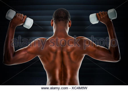 Composite image of rear view of a fit shirtless man lifting dumbbells - Stock Photo