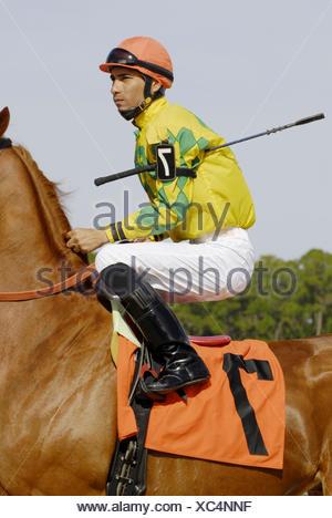 Jockey thoroughbred horse racing at Tampa Bay Downs in Tampa. Florida. USA - Stock Photo
