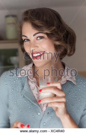 Woman drinking glass of milk - Stock Photo