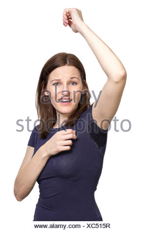 Woman sweating very badly under armpit - Stock Photo