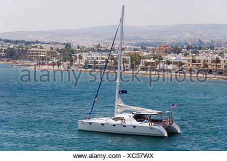A catamaran leaving the Paphos harbor, South Cyprus, Europe - Stock Photo