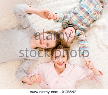 pregnant woman, girl and boy on bed - Stock Photo