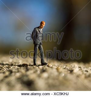 Solitary male figure alone walking - Stock Photo