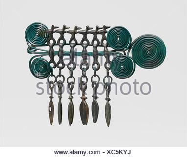Large Brooch. Date: 1100-1000 BC; Culture: European Bronze Age; Medium: Copper alloy; Dimensions: Overall: 11 1/8 x 7 11/16 x 1 11/16 in. (28.2 x - Stock Photo