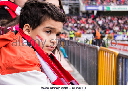 Spain, Madrid, Boy (6-7) at football match - Stock Photo