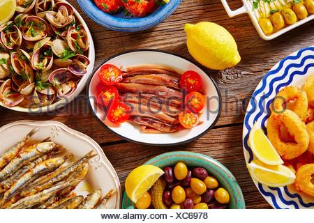 Tapas spanish seafood clams shrimps and fried anchovies fish. - Stock Photo