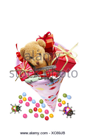 Pink schultuete or school cone filled with gifts and sweets - Stock Photo