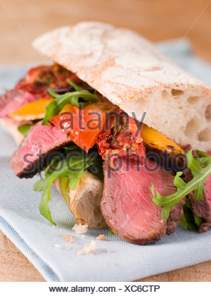 Sirloin Steak and Roasted Pepper Ciabatta Sandwich - Stock Photo