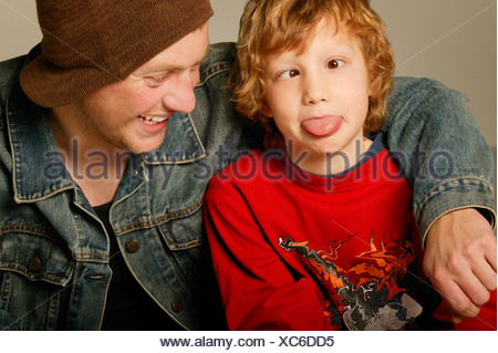 Young boy with young adult goofing around - Stock Photo