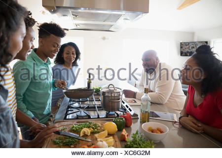 African American family cooking in kitchen - Stock Photo