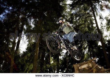 Forest, mountain biker, jump, from below, - Stock Photo